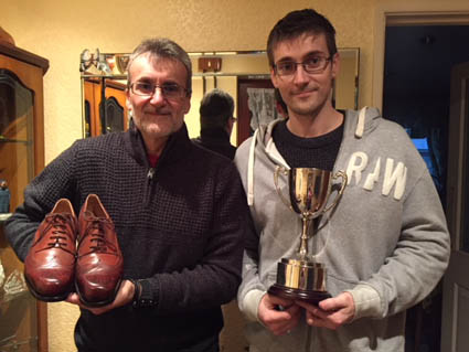Chris Thorne from Bill Bird Shoes (r) with his trophy alongside his dad Mick, who is holding the winning shoes.