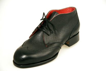 Black grain derby boots with red lining and wing caps