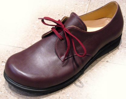 Burgundy foot shaped derby shoes