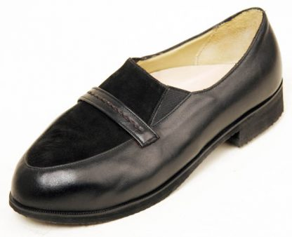 Elastic sided shoe with laid under apron and band
