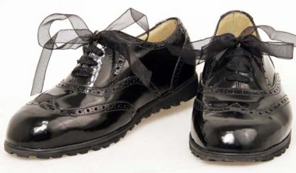 Women's black patent wedge Oxfords pair