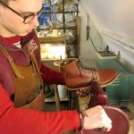 George, a bespoke shoemaker at Bill Bird Shoes, trims a heavy leather sole