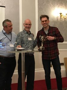 George being presented with his award by Conference organiser Tony Slinger and Bill Bird