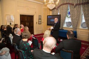 Bill Bird introduces the films to an invited audience of British and international footwear specialists at a gala dinner in London.
