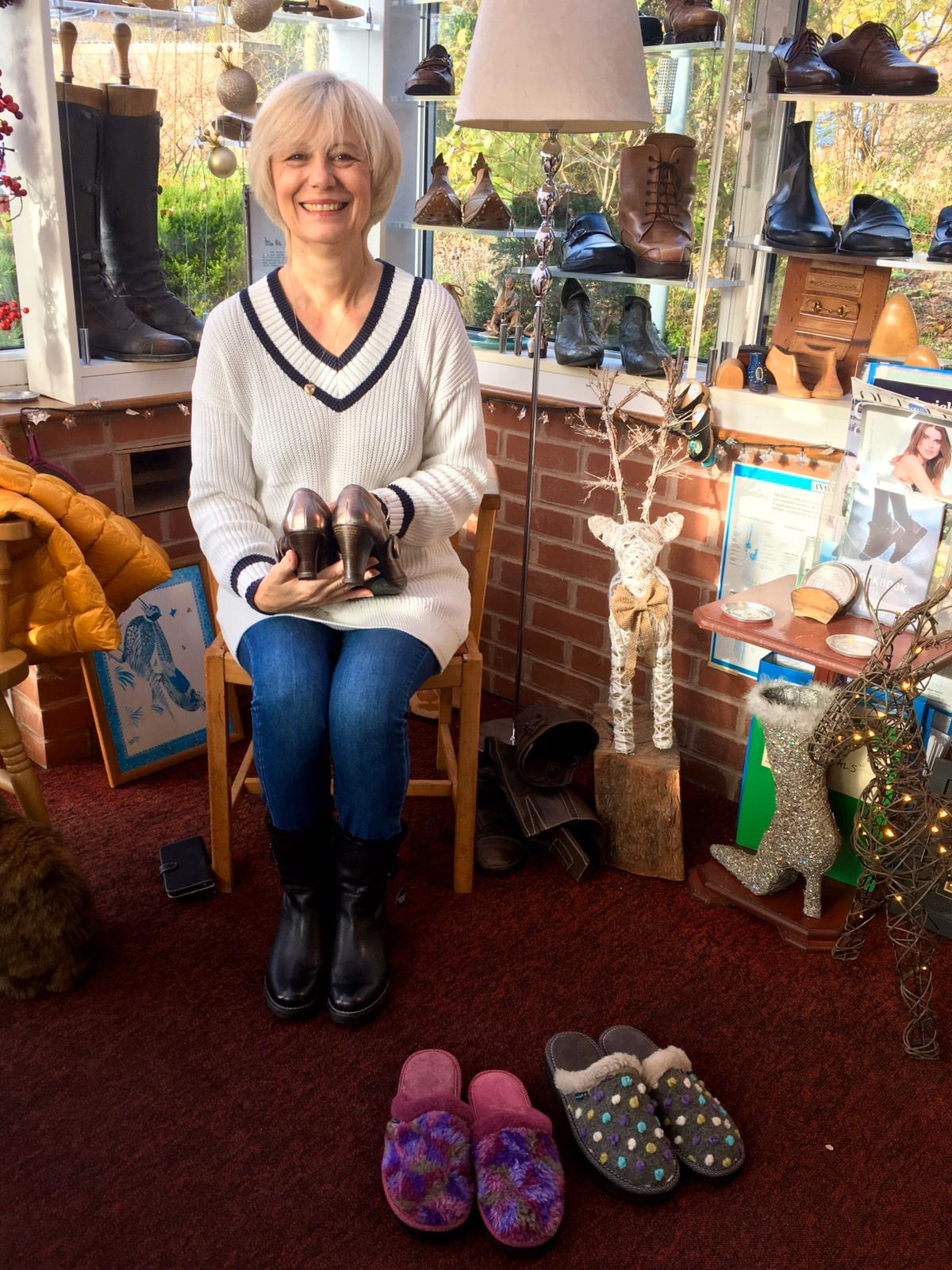 Carole Arnold has her shoes fitted at Bill Bird Shoes in the Cotswolds