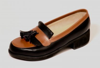 slip on casuals enclosing ankle foot orthosis with laid on apron, laid on band with leather tassels and rolled edge single