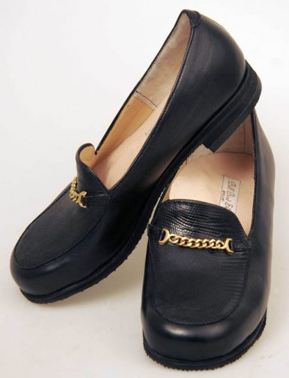 black calf and lizard slip-ons