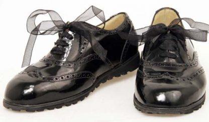 Women's black patent wedge Oxfords pair