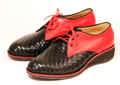 Red Derbyettes with woven leather vamps and wedge soles for a splay foot condition pair