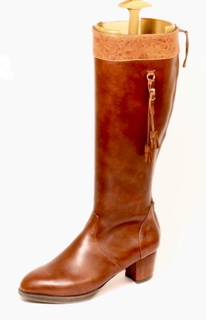 Womens knee length boots for retracted toes zip up back and long tassel details