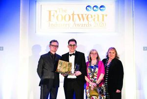 George receives his Student Shoe Fitter of the Year Award from comedian Ian Moore (l), Rosemary Gray President of the Society of Shoe Fitters and Laura West Secretary of the Society of Shoe Fitters (r) at the prestigious Footwear Industry Awards ceremony in Birmingham.